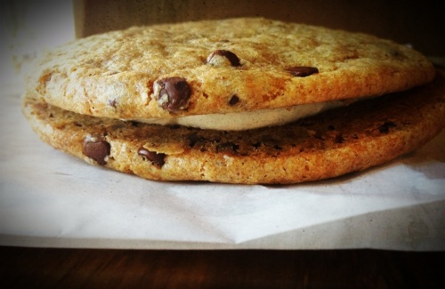 Chocolate Chip Cookie sandwich with vanilla frosting in the middle sweet theory baking co