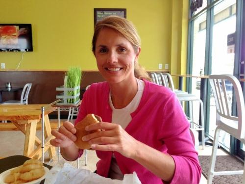 jennifer eating gluten free hamburger epik burger jacksonville